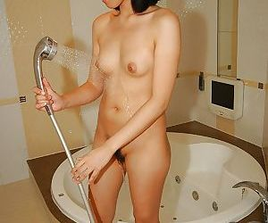 Shy asian sweetie taking shower and teasing her hairy..