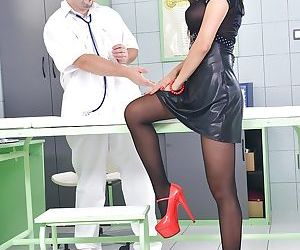 Big tits Asian PussyKat has her pantyhose on while in a..
