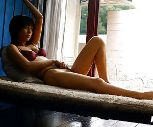 Slim asian babe with petite tits Rin Suzuka slipping off..