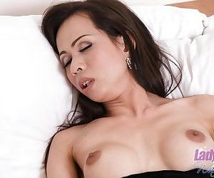 Skinny small dick Asian ladyboy Tai wanking off her cock..