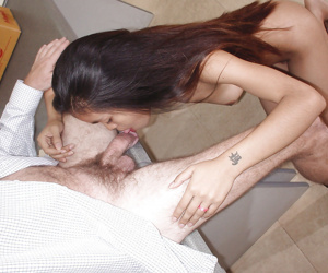 Foxy asian girl with tiny tits sucking a big cock and..