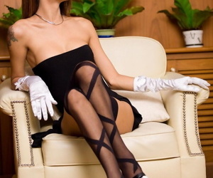 Glamorous ladyboy Dada shows high heels & takes a black..
