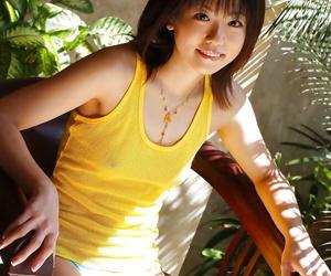 Asian coed Saki Ninomiya uncovering her tiny titties and..