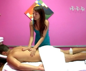 Asian brunette Layla Mynxx is giving a good massage and..