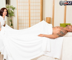 Asian granny Kim Anh gets on top a big cock during the..