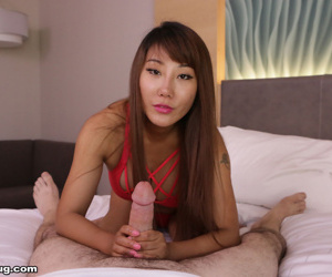 Asian chick Tiffany Rain coaxes the jizz from a cock with..