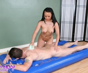 Asian MILF gives a soapy erotic massage and jerks off her..