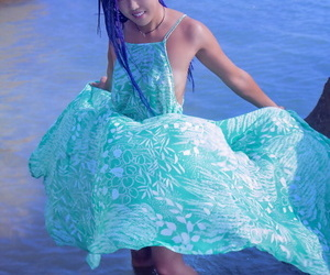 Hot Asian teen Sweet Julie removes wet dress for nude..