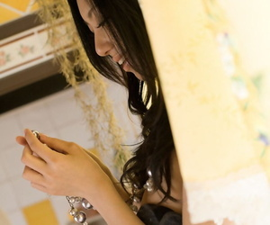 Japanese teen Aino Kishi lifts her dress to free bush from..