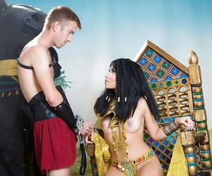Asian brunette Rina Ellis fucking big dick in Cleopatra..