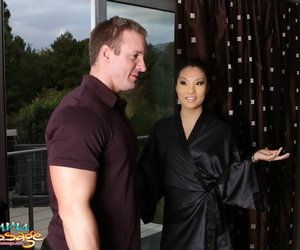 Asian masseuse Asa Akira oiling and soaping up for nude..