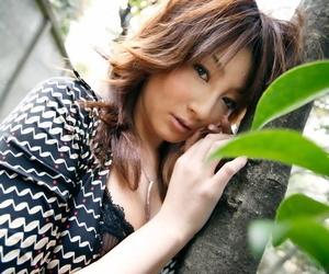 Japanese beauty Reinaa Mizuki is caught naked on her bed..
