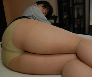 Asian MILF strips down and gets her hairy cunt pleased by..