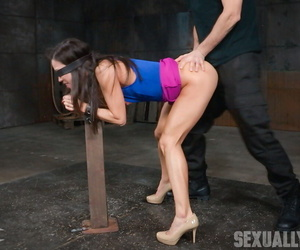 Asian chick Kalina Ryu is restrained by the wrists and..