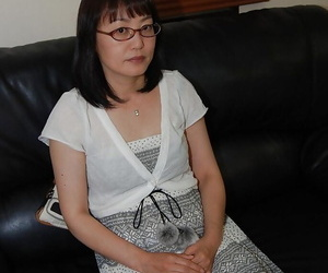 Shy asian lady in glasses strips down and has some pussy..