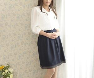 Pale Asian girl Aoi Miyama disrobes to pose showing small..