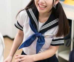 Cute Japanese schoolgirl lifts her skirt to masturbate for..
