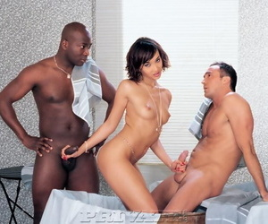 Asian pornstar does a DP with big black and white cocks..