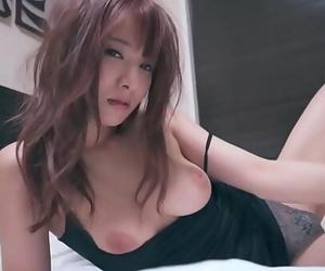 Mion Sonoda busty JAV star undressing in sofa