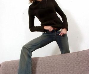 Long legged girl Michelle slides off jeans as she peels..