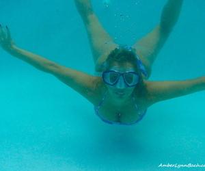 Fledgling lady Amber Lynn Bach peels off her swimsuit..