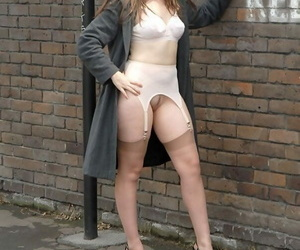 Solo model Jess Wood flashes in a back alley in retro..