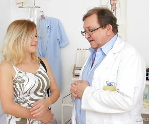 Blonde milf Karen is being checked by her nasty doctor in..