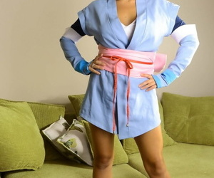 Solo model Sophie Parker releases her huge tits and slit..