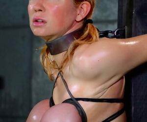 Nude redhead Rain DeGrey has hooters & arms cruelly bound..