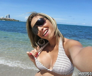 Latina stunner Patty drops her swimsuit brassiere and..