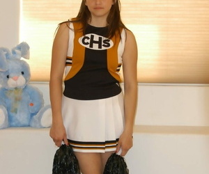 Sexy cheerleader with a pierced tongue Michelle playing..