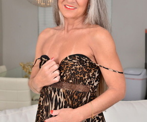 Grey haired granny Leilani Lei shows her little tits with..