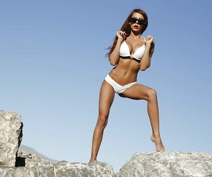 Chesty centerfold model Madison Ivy posing outdoors in..