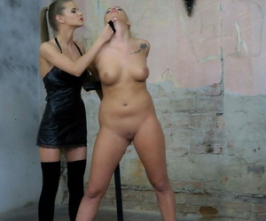 Trussed up lesbian Daisy Lee gets pleasured by a dominant..