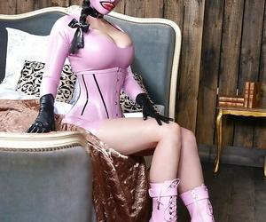 Top fetish model Latex Lucy posing in her recent..