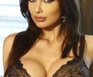 European brunette Aletta Ocean reveals her thick tits in..