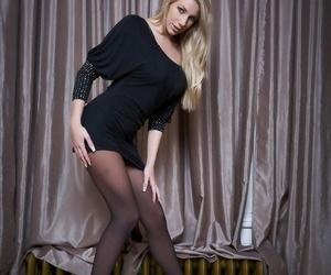 Beautiful blonde chick Danielle Maye rolls off her tights..