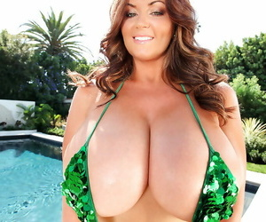 Outdoor posing at the pool features huge boobs pornstar..