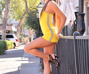 Young cutie Carmen showcases her plasticity and upskirt..