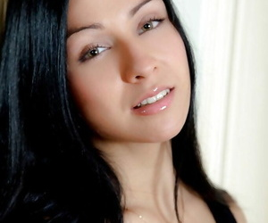Raven-haired teenage bombshell stripping and riding a big..