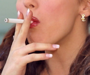 Glamour model takes off all her clothes while smoking a..