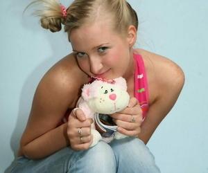 Slurps blond teen Inga wears her hair in puffballs while..