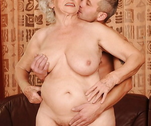 Buxomy granny gets a voiced cock in her cunt and gets her..