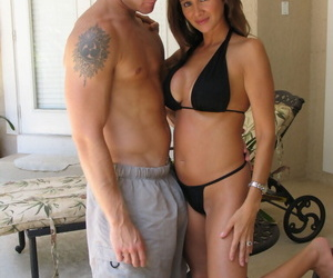 Latina Mummy frees stiff tits from a swimsuit before a..
