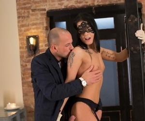 Brunette chick entices her guy in nylons and a masquerade..