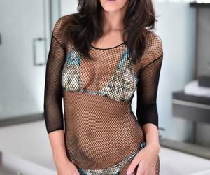 Brown-haired female Whitney Westgate takes off a..