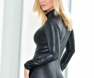 Hot solo model Kleio Valentien peels off a cat suit to..