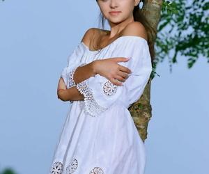 Tongues teen Jennifer Hart slides out of a white sundress..