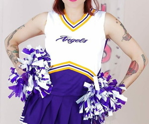 Inked schoolgirl cheerleader undresses for mouth to mouth..