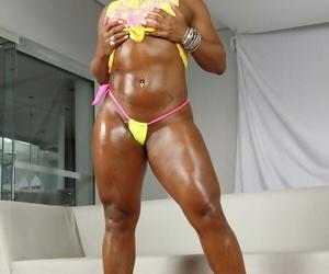 Oiled Latina MILF Ana Julia posing huge huge arse in high..